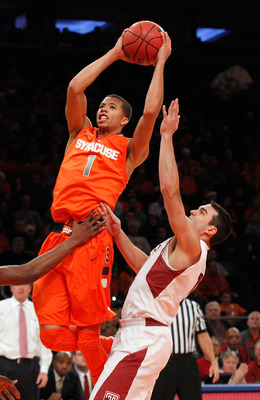 NEW YORK, NY - DECEMBER 22:  Michael Carter-Williams #1 of the Syracuse Orange drives towards the net against Temple Owls during the Gotham Classic at Madison Square Garden on December 22, 2012 in New York City. Temple Owls defeated the Syracuse Orange 83