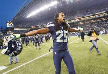 SEATTLE, WA - DECEMBER 30:  Cornerback Richard Sherman #25 of the Seattle Seahawks celebrates as he leaves the field after defeating the St. Louis Rams 20-13 at CenturyLink Field on December 30, 2012 in Seattle, Washington.  (Photo by Otto Greule Jr/Getty