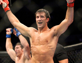 July 14, 2012; Portland, OR, USA; Luke Rockhold celebrates his win over Tim Kennedy in the middleweight championship fight at MMA Strikeforce at the Rose Garden Arena. Mandatory Credit: Scott Olmos-USA TODAY Sports