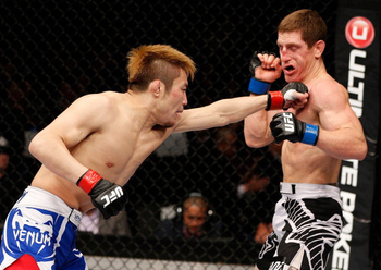 Takanori Gomi punches Mac Danzig at UFC on Fuel 6 (Josh Hedges/Zuffa LLC/Zuffa LLC via Getty Images)