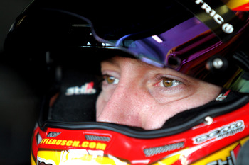 HOMESTEAD, FL - NOVEMBER 17:  Kyle Busch, driver of the #18 M&M's Toyota, looks in the garage during practice for the NASCAR Sprint Cup Series Ford EcoBoost 400 at Homestead-Miami Speedway on November 17, 2012 in Homestead, Florida.  (Photo by Jerry Markl