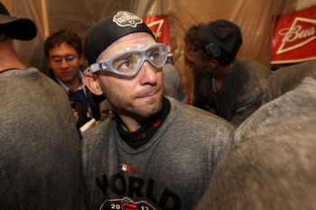 Postseason hero Marco Scutaro has signed through 2015.