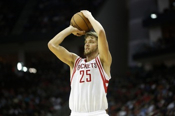Dec 19, 2012; Houston, TX, USA; Houston Rockets small forward Chandler Parsons (25) shoots a three point shot against the Philadelphia 76ers during the third quarter at the Toyota Center. The Rockets won 125-103. Mandatory Credit: Thomas Campbell-USA TODA