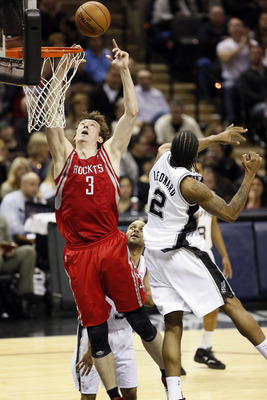Dec 28, 2012; San Antonio, TX, USA; Houston Rockets center Omer Asik (3) gets fouled on his way to the basket by San Antonio Spurs guard Tony Parker (bottom) during the second half at the AT&amp;T Center. Mandatory Credit: Soobum Im-USA TODAY Sports