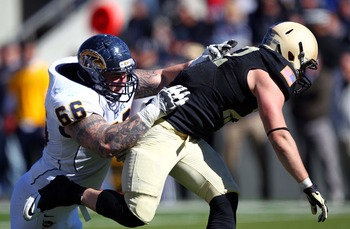 Brian Winters takes on Army defender.