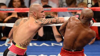 Mayweather, pictured right, slipping a punch thrown by Miguel Cotto.