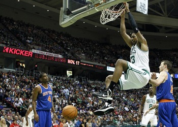 Oct 20, 2012; Albany, NY, USA; Boston Celtics center Fab Melo (13) dunks against the New York Knicks during the first half at Times Union Center.  Mandatory Credit: Mark L. Baer-USA TODAY Sports