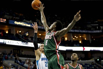 Dec 3, 2012; New Orleans, LA, USA; Milwaukee Bucks center Larry Sanders (8) blocks a shot by New Orleans Hornets shooting guard Austin Rivers (25) during the second quarter of a game at the New Orleans Arena.  Mandatory Credit: Derick E. Hingle-USA TODAY