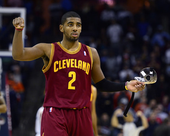 Jan 4, 2013; Charlotte, NC, USA; Cleveland Cavaliers point guard Kyrie Irving (2) reacts during the second half against the Charlotte Bobcats at Time Warner Cable Arena. Mandatory Credit: Curtis Wilson-USA TODAY Sports