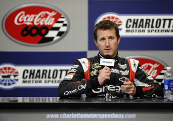 CONCORD, NC - DECEMBER 12:  Kasey Kahne, driver of the #5 Great Clips Chevrolet, speaks with the media during testing at Charlotte Motor Speedway on December 12, 2012 in Concord, North Carolina.  (Photo by Jared C. Tilton/Getty Images for NASCAR)