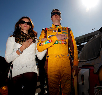 AVONDALE, AZ - NOVEMBER 11:  Kyle Busch (R), driver of the #18 M&M's Toyota, stands on the grid with his wife Samantha (L) prior to the NASCAR Sprint Cup Series AdvoCare 500 at Phoenix International Raceway on November 11, 2012 in Avondale, Arizona.  (Pho