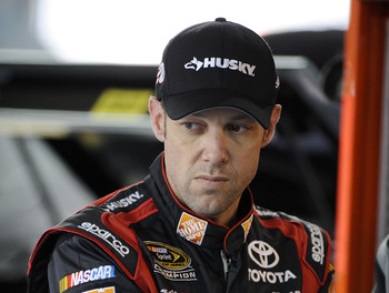 CONCORD, NC - DECEMBER 12:  Matt Kenseth, driver of the #20 Home Depot/Dollar General/Husky Toyota, stands in the garage area during testing at Charlotte Motor Speedway on December 12, 2012 in Concord, North Carolina.  (Photo by Jared C. Tilton/Getty Imag