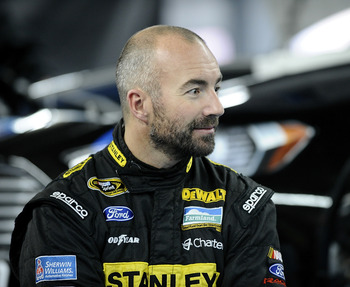 CONCORD, NC - DECEMBER 12:  Marcos Ambrose, driver of the Richard Petty Motorsports Ford, sits in the garage area during testing at Charlotte Motor Speedway on December 12, 2012 in Concord, North Carolina.  (Photo by Jared C. Tilton/Getty Images for NASCA