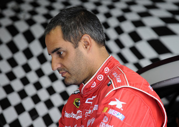 CONCORD, NC - DECEMBER 11:  Juan Pablo Montoya, driver of the #42 Target Chevrolet, looks on in the garage area during testing at Charlotte Motor Speedway on December 11, 2012 in Concord, North Carolina.  (Photo by Jared C. Tilton/Getty Images for NASCAR)