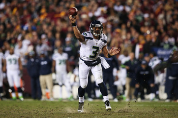 LANDOVER, MD - JANUARY 06:  Russell Wilson #3 of the Seattle Seahawks throws the ball in the second quarter of their NFC Wild Card Playoff Game against the Washington Redskins at FedExField on January 6, 2013 in Landover, Maryland.  (Photo by Win McNamee/