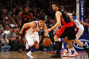 NEW YORK, NY - MARCH 20:  Jeremy Lin #17 of the New York Knicks steals the ball in the second half against Andrea Bargnani #7 of the Toronto Raptors at Madison Square Garden on March 20, 2012 in New York City.  NOTE TO USER: User expressly acknowledges an