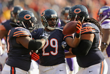 Michael Bush celebrates with teammates after a touchdown against the Vikings