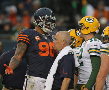 Julius Peppers (90) confronts Packers quarterback Aaron Rodgers (12)