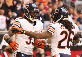 Tim Jennings (26) congratulates Charles Tillman (33) following an interception against the Arizona Cardinals.