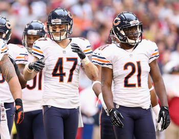 Starting safeties Chris Conte (47) and Major Wright (21)