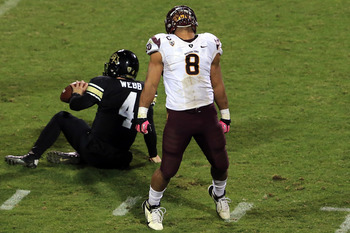 Magee celebrates a sack against Colorado.