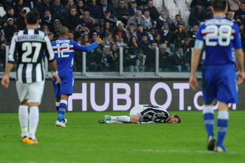 Juventus midfielder Claudio Marchisio writhes in agony during the defeat by Sampdoria.