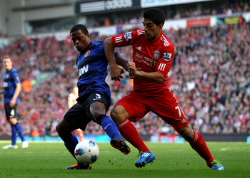 Luis Suarez challenges Patrice Evra at Anfield in October 2011.