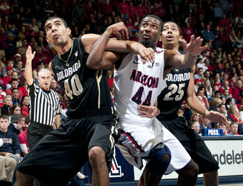Jan 3, 2013; Tucson, AZ, USA; Colorado Buffaloes forward Josh Scott (40) and guard Spencer Dinwiddie (25) and Arizona Wildcats forward Solomon Hill (44) battle for positioning during a free throw attempt during the second half at McKale Center. The Wildca