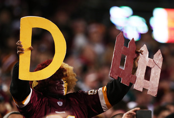 LANDOVER, MD - JANUARY 06:  A Washington Redskins fan hold up signs for defense during their NFC Wild Card Playoff Game against the Seattle Seahawks at FedExField on January 6, 2013 in Landover, Maryland.  (Photo by Win McNamee/Getty Images)