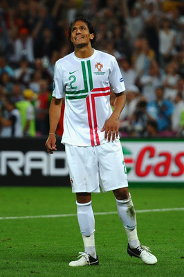 DONETSK, UKRAINE - JUNE 27: Bruno Alves of Portugal reacts after hitting the bar from the penalty spot  during the UEFA EURO 2012 semi final match between Portugal and Spain at Donbass Arena on June 27, 2012 in Donetsk, Ukraine.  (Photo by Laurence Griffi