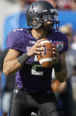 Jan 1, 2013; Jacksonville FL, USA; Northwestern Wildcats quarterback Kain Colter (2) looks for a receiver in the first quarter of their Gator Bowl game against the Mississippi State Bulldogs at EverBank Field. The Northwestern Wildcats beat the Mississipp