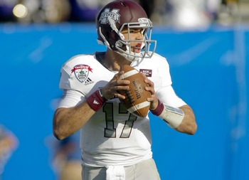 Jan 1, 2013; Jacksonville FL, USA; Mississippi State Bulldogs quarterback Tyler Russell (17) drops back to pass in the fourth quarter of the Gator Bowl game against the Northwestern Wildcats at EverBank Field. Has was sacked on the play. The Northwestern