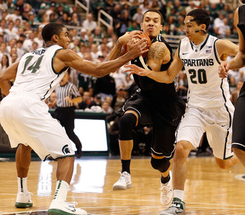 Travis Trice (right with mask) is Michigan State's hustle man off the bench.