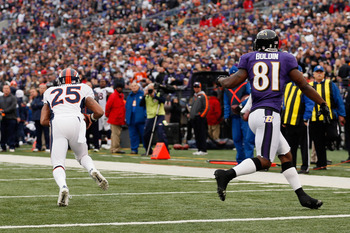Chris Harris returns an interception for a touchdown in the first meeting between Denver and Baltimore.