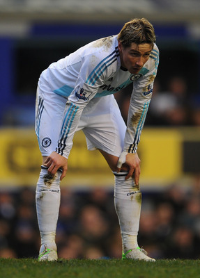 LIVERPOOL, ENGLAND - DECEMBER 30:  Fernando Torres of Chelsea looks on during the Barclays Premier League match between Everton and Chelsea at Goodison Park on December 30, 2012 in Liverpool, England. (Photo by Michael Regan/Getty Images)