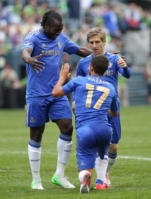 SEATTLE, WA - JULY 18:  Eden Hazard #17 of Chelsea FC is congratulated by Romelu Lukaku #18 (L) and Marko Marin #21 after scoring a goal against the Seattle Sounders FC at CenturyLink Field on July 18, 2012 in Seattle, Washington.  (Photo by Otto Greule J