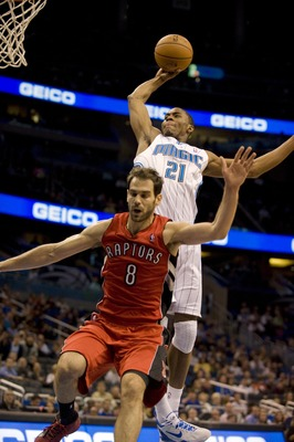 Dec 29, 2012; Orlando, FL, USA; Orlando Magic forward Maurice Harkless (21) attempts a dunk over guard Jose Calderon (8) during the game at the Amway Center. Mandatory Credit: Jeff Griffith-USA TODAY Sports