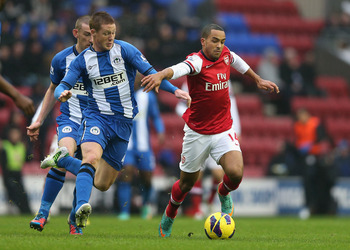 Wigan midfielder James McCarthy may be playing alongside Theo Walcott for Arsenal according to reports.