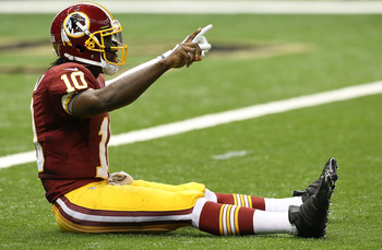 Robert Griffin III struck this pose after tossing his first career touchdown pass against the New Orleans Saints.