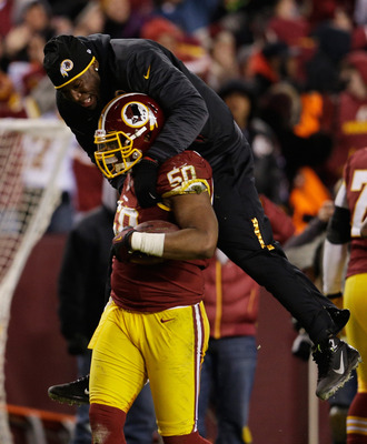 Rob Jackson celebrated with Brian Orakpo after his season-saving interception late in Week 17 against Dallas.