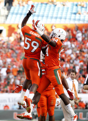 MIAMI GARDENS, FL - NOVEMBER 17: Jimmy Gaines #59 is congratulated by Kelvin Cain #94 of the Miami Hurricanes after scoring a touchdown against the South Florida Bulls on November 17, 2012 at Sun Life Stadium in Miami Gardens, Florida. The Hurricanes defe