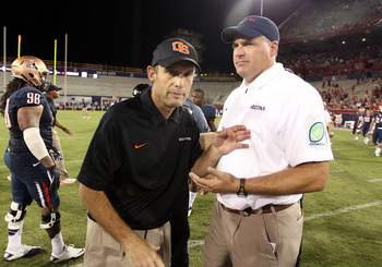 (l to r) Mike Riley and Rich Rodriguez
