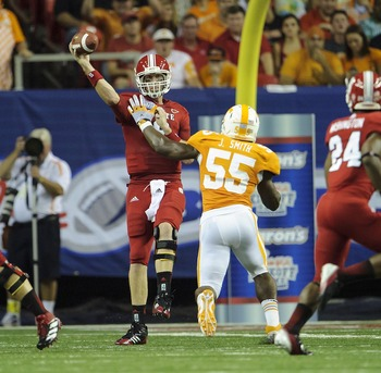 Aug 31, 2012; Atlanta, GA, USA; North Carolina State Wolfpack quarterback Mike Glennon (8) attempts a pass under pressure by Tennessee Volunteers linebacker Jacques Smith (55) during the game at the Georgia Dome. Tennessee won 35-21. Mandatory Credit: Pau