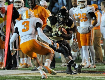 NASHVILLE, TN - NOVEMBER 17: Running back Zac Stacy #2 of the Vanderbilt Commodores rushes against Byron Moore #3 of the University of Tennessee at Vanderbilt Stadium on November 17, 2012 in Nashville, Tennessee. (Photo by Frederick Breedon/Getty Images)