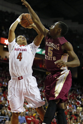 Jan 9, 2013; College Park, MD, USA; Florida State Seminoles guard Montay Brandon (5) defends against Maryland Terrapins guard Seth Allen (4) at the Comcast Center. Mandatory Credit: Mitch Stringer-USA TODAY Sports