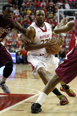 Jan 9, 2013; College Park, MD, USA; Maryland Terrapins guard Dez Wells (32) drives to the basket past Florida State Seminoles guard Montay Brandon (5) at the Comcast Center. Mandatory Credit: Mitch Stringer-USA TODAY Sports