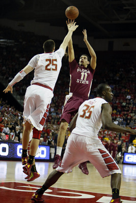 Jan 9, 2013; College Park, MD, USA; Florida State Seminoles guard Kiel Turpin (11) shoots over Maryland Terrapins center Alex Len (25) at the Comcast Center. Mandatory Credit: Mitch Stringer-USA TODAY Sports