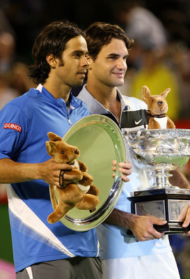 MELBOURNE, AUSTRALIA - JANUARY 28:  Roger Federer of Switzerland and Fernando Gonzalez of Chile hold the trophies after their men's final match on day fourteen of the Australian Open 2007 at Melbourne Park on January 28, 2007 in Melbourne, Australia.  (Ph