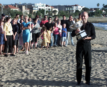 28 Jan 2001:  Andre Agassi of the USA poses with the Australian Open trophy at St.Kilda Beach after winning the Final of the Australian Open Tennis Championships against Arnaud Clement of France, played at Melbourne Park in Melbourne, Australia. Agassi de