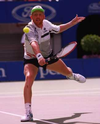 28 Jan 1996:   Boris Becker of Germany returns against Michael Chang of the USA in the mens singles final of the Ford Australian Open at Flinders Park in Melbourne, Australia. Becker won the match in four sets 6-2, 6-4, 2-6, 6-2 to take the Championship.M